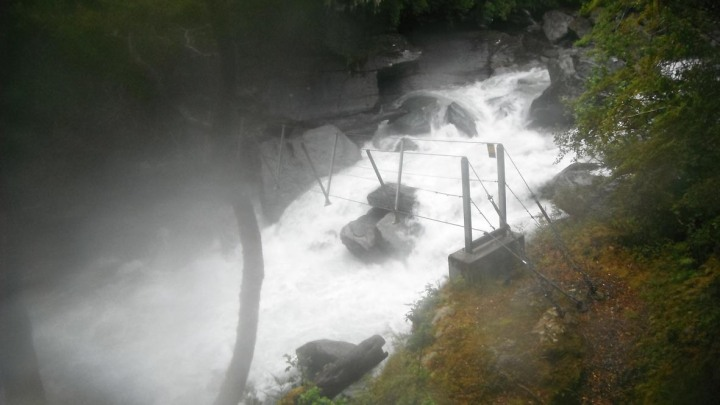 Scary stuff. A wire bridge over a raging torrent. Mt Aspiring National Park, New Zealand.